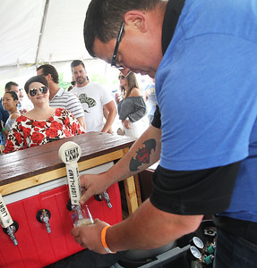 Candace H. Johnson-For Shaw Media Kristin Zidron, of Grayslake waits for a sample of Light the Lamp beer from Keith Baker, of Antioch, a volunteer, during the 6th Annual Grayslake Craft Beer Festival in downtown Grayslake.(6/2/18)