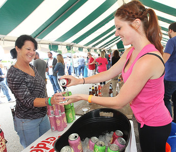 Candace H. Johnson-For Shaw Media Lori Korbas, of Lake Villa gets a sample of 2 Fools Cider from Jessica Ghilardi, of Tinley Park during the 6th Annual Grayslake Craft Beer Festival in downtown Grayslake.Korbas was at the event with her friend, Mary Sweeney, of Gurnee.(6/2/18)