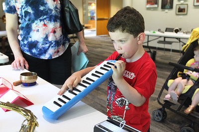 Candace H. Johnson-For Shaw Media Maximus Peterson, 5, of North Barrington plays a Melodica during the Musical Petting Zoo event at the Wauconda Area Library.Maximus was at the event with his mother, Jill.(6/4/18)