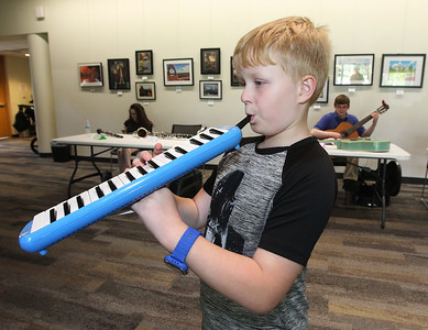 Candace H. Johnson-For Shaw Media Dean Boelke, 8, of Ingleside plays the Melodica during the Musical Petting Zoo event at the Wauconda Area Library.Dean was at the event with his mother, Sherri.(6/4/18)