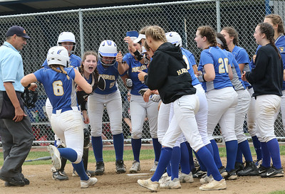 Candace H. Johnson-For Shaw Media Warren's Ashlyn Kitter comes into the huddle at home plate as she is congratulated for her home run against Palatine in the third inning during the Class 4A sectional final game at Warren Township High School. Palatine won 11-5. (6/2/18)