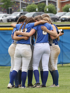 Candace H. Johnson-For Shaw Media A group of Warren varsity softball players get into a huddle as they support each other after their loss to Palatine during the Class 4A sectional final game at Warren Township High School. Palatine won 11-5. (6/2/18)