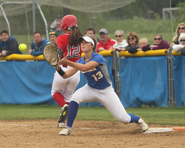 Candace H. Johnson-For Shaw Media Palatine's Kaitlyn Reed makes it safely to first as Warren's Kayla Nommensen waits for the throw in the third inning during the Class 4A sectional final game at Warren Township High School. Palatine won 11-5. (6/2/18)