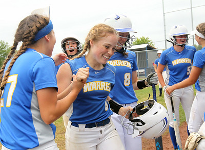 Candace H. Johnson-For Shaw Media Warren's Kelly Beck (#27) congratulates Ashlyn Kitter for her home run against Palatine as she makes her way back to the dugout in the third inning during the Class 4A sectional final game at Warren Township High School. Palatine won 11-5. (6/2/18)