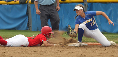 Candace H. Johnson-For Shaw Media Palatine's Brittany Padden slides safely back to first before the tag by Warren's Kayla Nommensen in the third inning during the Class 4A sectional final game at Warren Township High School. Palatine won 11-5. (6/2/18)