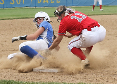 Candace H. Johnson-For Shaw Media Warren's Caitlyn Britton slides to third under the tag by Palatine's Maddie Craver for an out in the fifth inning during the Class 4A sectional final game at Warren Township High School. Palatine won 11-5. (6/2/18)