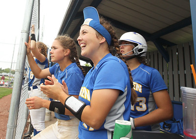 Candace H. Johnson-For Shaw Media Warren's Claire Swedberg, Kelly Beck and Kayla Nommensen cheer for their team in the dugout in the third inning during the Class 4A sectional final game at Warren Township High School. Palatine won 11-5. (6/2/18)