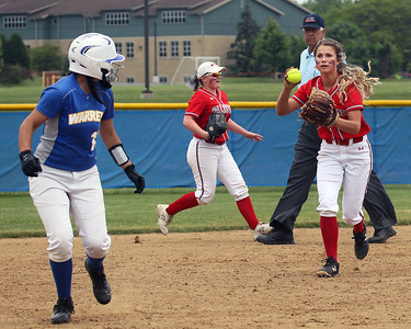 Candace H. Johnson-For Shaw Media Warren's Kassie Jimenez looks back as she is caught between second and third as Palatine's Emily Parrott goes after her for an out in the fourth inning during the Class 4A sectional final game at Warren Township High School. Palatine won 11-5. (6/2/18)