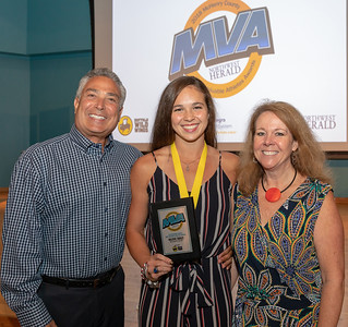 Prairie Ridge's Valerie Tarazi (center) selected 2018 Female Athlete of the Year and her parents, Marty and Jana Tarazi, at the 2018 Northwest Herald's Most Valuable Athlete Awards Thursday, June 7, 2018 at McHenry County College in Crystal Lake.  KKoontz – For Shaw Media