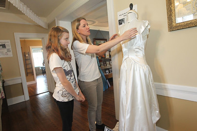 "Candace H. Johnson-For Shaw Media Keira Stanley, 12, of Wauconda listens to her mother, Pamela, talk about how she restored her grandmother, Jean Kress', 1949 wedding dress so she could wear it at her own wedding in 2002 which sits on display at the Wauconda Area ""Weddings and Gowns Through the Years"" exhibit at the Andrew C. Cook House on Main Street in Wauconda. The exhibit was presented by the Wauconda Township Historical Society.The exhibit will run for three more Saturdays from 1-4 pm on June 16th, June 23rd and June 30th. (6/9/18)"