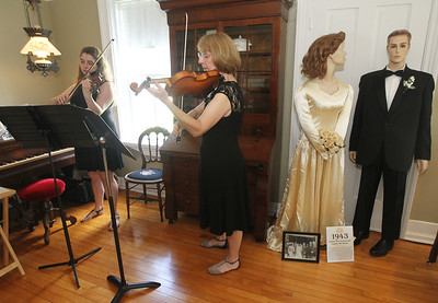 "Candace H. Johnson-For Shaw Media Violinists Carissa McQuaid and her mother, Lisabeth, both of Wauconda play Pachelbell's Canon in D at the Wauconda Area ""Weddings and Gowns Through the Years"" exhibit at the Andrew Cook House on Main Street in Wauconda. The exhibit was presented by the Wauconda Township Historical Society.The exhibit will run for three more Saturdays from 1-4 pm on June 16th, June 23rd and June 30th.(6/9/18)"