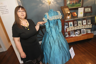 "Candace H. Johnson-For Shaw Media Cindy Graff, of Lakemoor, vice-president of the Wauconda Township Historical Society, talks about the 1895 wedding dress made and worn by Minnie Mae Mills when she wed Arthur Eugene Kirwan at the Wauconda Area ""Weddings and Gowns Through the Years"" exhibit at the Andrew C. Cook House on Main Street in Wauconda. Mills had two children and died at the age of twenty-four.The dress was donated by her family to the Wauconda Township Historical Society.The exhibit will run for three more Saturdays from 1-4 pm on June 16th, June 23rd and June 30th.(6/9/18)"