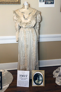 "Candace H. Johnson-For Shaw Media A 1907 wedding dress worn by Anna Stilling Brown when she married her husband, John, was on display along with her picture at the Wauconda Area ""Weddings and Gowns Through the Years"" exhibit at the Andrew C. Cook House on Main Street in Wauconda. The exhibit was presented by the Wauconda Township Historical Society.(6/9/18)"