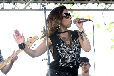 "Candace H. Johnson-For Shaw Media Bernadette Garza, lead singer with the Deja Vu band, sings Lady Gaga's song, ""Poker Face,"" during the Village of Lake Villa's Celebration of Summer at Lehmann Park.(6/9/18)"