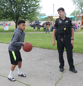 Candace H. Johnson-For Shaw Media Michael Jefferson, 13, of Lake Villa aims for the hoop as he plays a basketball game called, Horse, with Lake Villa Police Officer Sean Kelly during the Village of Lake Villa's Celebration of Summer at Lehmann Park.(6/9/18)