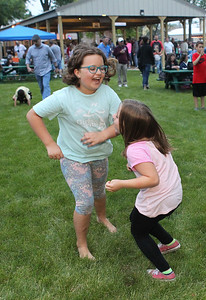 Candace H. Johnson-For Shaw Media Zoe McMillan, 9, of Volo and Molly Linderman, 7, of Antioch dance to the music played by the Deja Vu band during the Village of Lake Villa's Celebration of Summer at Lehmann Park.(6/9/18)