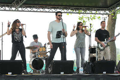 Candace H. Johnson-For Shaw Media Bernadette Garza, Chris DePinto, Jeff Anthony, Jen Knuepfer and Bill Losquadro, all with the band, Deja Vu, sing a variety of music during the Village of Lake Villa's Celebration of Summer at Lehmann Park.Roman Niziolek, bass guitarist, also performed with the band.(6/9/18)