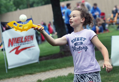 Candace H. Johnson-For Shaw Media Avery McMillan, 11, of Volo makes the catch as she plays wiffle ball with her friend during the Village of Lake Villa's Celebration of Summer at Lehmann Park.(6/9/18)