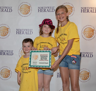 Cameron Christianson, Lila Christianson and Emma Blanken from the Lemonade Brigade celebrate their 2018 Best of the Fox award for Best Fundraising Event by a Non-Profit on Thursday, June 14, 2018 at Lakeside Legacy Arts Park in Crystal Lake. KKoontz – For Shaw Media
