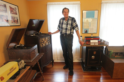 "Candace H. Johnson-For Shaw Media Ron Wendt, of Gurnee, president of the Warren Township Historical Society, plays a song by the Peerless Quartette on a 1916 Victrola at the Mother Rudd House in Gurnee.Wendt says, ""it still works and you don't have to plug it in.""(6/11/18)"