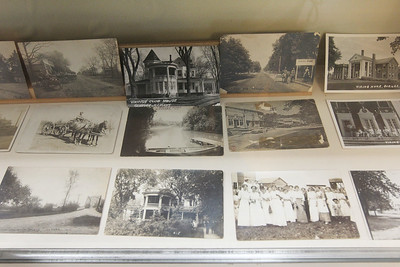Candace H. Johnson-For Shaw Media Several old photographs of Warren Township were on display in a glass case at the Mother Rudd House in Gurnee. (6/11/18)