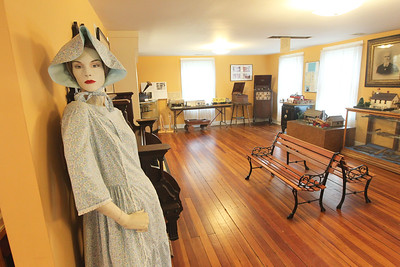 Candace H. Johnson-For Shaw Media A mannequin wearing a 1970's dress worn for the Gurnee Days Parade stands in the parlor of the Mother Rudd House in Gurnee. (6/11/18)