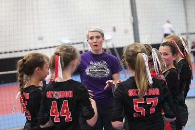 Candace H. Johnson-For Shaw Media Sky High's Jen Hein, of Grayslake talks to her Adidas 12-1 NS team after they beat the Chicago Elite 12-2's team during the National Warm-Up tournament at Sky High Volleyball in Libertyville. Sky High won 16-25, 25-18, 15-6.(6/9/18)