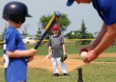 Candace H. Johnson-For Shaw Media Diamondbacks Alphie McDonald (center) watches Cubs Jackson Adams get ready to swing during the 4-5 years old T-Ball League game at Alleghany Park in Grayslake. The games are sponsored by the Grayslake Park District.(6/16/18)