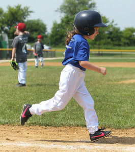 Candace H. Johnson-For Shaw Media Cubs Kelsie Soehl runs to first after hitting the ball against the Diamondbacks during the 4-5 years old T-Ball League game at Alleghany Park in Grayslake. The games are sponsored by the Grayslake Park District.(6/16/18)
