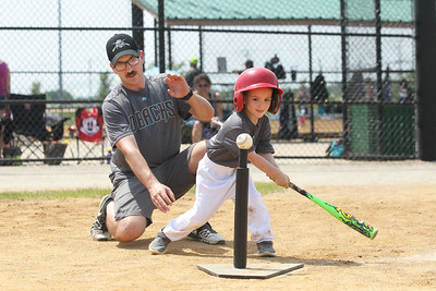 Candace H. Johnson-For Shaw Media Diamondbacks Ben Cosens, of Grayslake, head coach, helps Camdyn Biggs take a swing against the Cubs during the 4-5 years old T-Ball League game at Alleghany Park in Grayslake. The games are sponsored by the Grayslake Park District.(6/16/18)