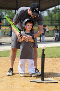 Candace H. Johnson-For Shaw Media Diamondbacks Ben Cosens, of Grayslake, head coach, helps Jack Bruntmyer with his swing against the Cubs during the 4-5 years old T-Ball League game at Alleghany Park in Grayslake. The games are sponsored by the Grayslake Park District.(6/16/18)