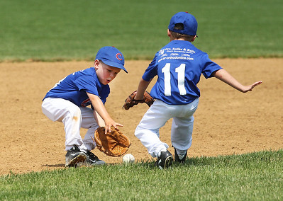 Candace H. Johnson-For Shaw Media Cubs Bradley Rosebraugh and Noah Warren go after a ground ball against the Diamondbacks during the 4-5 years old T-Ball League game at Alleghany Park in Grayslake. The games are sponsored by the Grayslake Park District.(6/16/18)