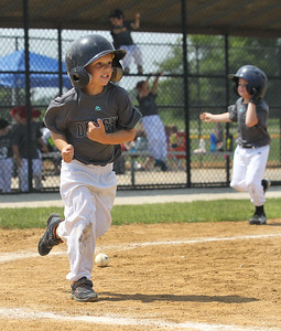 Candace H. Johnson-For Shaw Media Diamondbacks Carson Hengl runs to first after his hit against the Cubs during the 4-5 years old T-Ball League game at Alleghany Park in Grayslake. The games are sponsored by the Grayslake Park District.(6/16/18)
