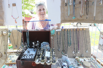 Candace H. Johnson-For Shaw Media Vicki LeGrand, of Lake Villa with Creatively Handmade, looks through a section of her booth with repurposed vintage pieces of jewelry she designed during the 3rd Saturday Market at the Lake Villa Train Station parking lot. The market runs on the 3rd Saturday, June through September, and features vendors, arts & crafts and individuals selling their treasures. The event was presented by the Lake Villa Historical Society.(6/16/18)