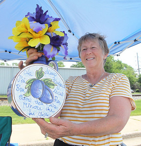 Candace H. Johnson-For Shaw Media Sue Ziccarelli, of Lindenhurst holds up a dried flower arrangement she was selling along with her other treasures during the 3rd Saturday Market at the Lake Villa Train Station parking lot. The market runs on the 3rd Saturday, June through September, and features vendors, arts & crafts and individuals selling their treasures. The event was presented by the Lake Villa Historical Society.(6/16/18)