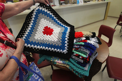 Candace H. Johnson-For Shaw Media Susan Noon, of Lindenhurst shows one of the nineteen blankets she hand-crocheted and was donating to Save-A-Pet in Grayslake. The blanket will be used for a cat or small dog. June is Adopt-A-Shelter Cat Month. (6/14/18)