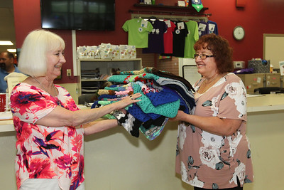 Candace H. Johnson-For Shaw Media Susan Noon, of Lindenhurst gives Deb Rabine, of McHenry, development coordinator, nineteen handmade crocheted blankets she was donating to Save-A-Pet in Grayslake. June is Adopt-A-Shelter Cat Month. (6/14/18)