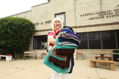 Candace H. Johnson-For Shaw Media Susan Noon, of Lindenhurst holds nineteen handmade crocheted blankets she was donating to the Save-A-Pet adoption center on Fairfield Road in Grayslake. June is Adopt-A-Shelter Cat Month. (6/14/18)