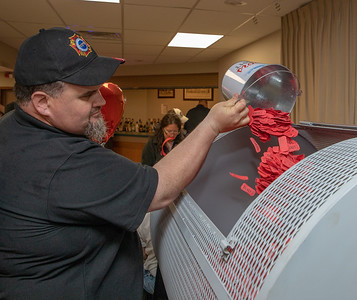 Ben Keefe adds yet another bucket of tickets for the $1.6 million Queen of Hearts drawing Tuesday, June 26, 2018 at the VFW in McHenry. There wasn't a jackpot winner this week and the jackpot will increase next week as the nine of hearts was selected. KKoontz – For Shaw Media