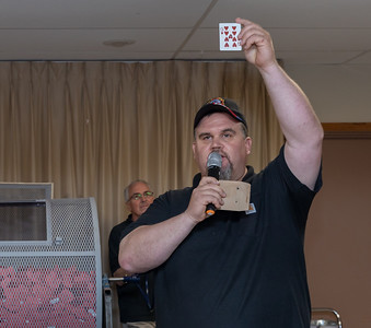 Ben Keefe holds up the nine of hearts forcing a roll-over jackpot yet again Tuesday, June 26th, at the McHenry VFW Queen of Hearts raffle drawing in McHenry. Next week's drawing is expected to reach $1.8 million. KKoontz – For Shaw Media