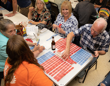 Dave Bothum and daughter, Tanya Young, organize their tickets Tuesday, June 26th, at the McHenry Queen of Hearts raffle drawing. The nine of hearts was selected this week, making next week's jackpot an expected $1.8 million. KKoontz – For Shaw Media