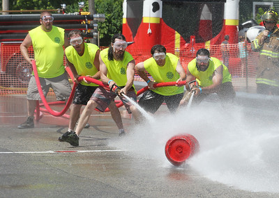 Candace H. Johnson-For Shaw Media Brian Herwerth, Eric Cook, Adam Michals, Tim Pokorney and Frank Rano with the The Gutter Guys, of Ingleside team compete against Fox Valley Fire & Safety during the Fox Lake Volunteer Fire Department's 60th annual Fireman's Festival on Washington Street in Fox Lake.(6/24/18)