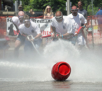 Candace H. Johnson-For Shaw Media The Top and Drop team compete against Dan's Mechanical Inc. (DMI) during the Fox Lake Volunteer Fire Department's 60th annual Fireman's Festival on Washington Street in Fox Lake.(6/24/18)