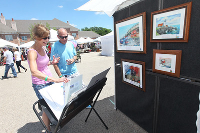 Candace H. Johnson-For Shaw Media Judy Sima and Jeff Clark, both of Grayslake look at oil and watercolor paintings by Jim Brooksher, a Grayslake artist, during the 23rd Annual Grayslake Arts Festival & Wine Tasting on Whitney Street in Grayslake.(6/23/18)