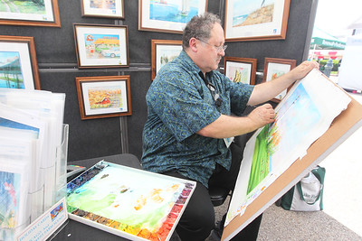 Candace H. Johnson-For Shaw Media Jim Brooksher, a Grayslake artist, works on his watercolor painting of the Wind Point Lighthouse in Racine, Wis., during the 23rd Annual Grayslake Arts Festival & Wine Tasting on Whitney Street in Grayslake. (6/23/18)