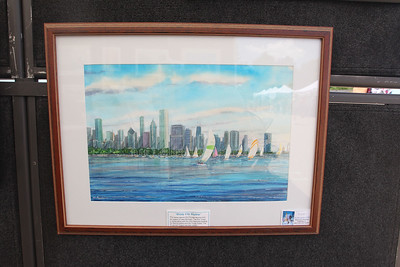 "Candace H. Johnson-For Shaw Media Jim Brooksher, a Grayslake artist, painted, ""Windy City Skyline,"" a watercolor painting for sale in the artist's booth during the 23rd Annual Grayslake Arts Festival & Wine Tasting on Whitney Street in Grayslake. (6/23/18)"