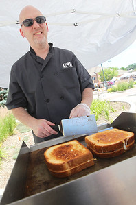 Candace H. Johnson-For Shaw Media Paul Patricelli, of Grayslake with GRIL, makes gourmet grill cheese sandwiches during the 23rd Annual Grayslake Arts Festival & Wine Tasting on Whitney Street in Grayslake.(6/23/18)