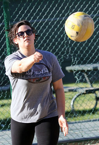Candace H. Johnson-For Shaw Media Katlynn Aquino, of Chicago with the Sandy Balls family team serves the ball against That's What She Set during the recreational volleyball game at Sideouts Sports Tavern in Island Lake.That's What She Set won 21-14, 21-13, 21-14. (6/24/18)