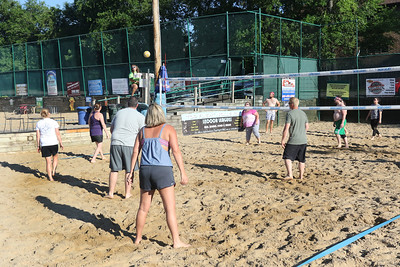 Candace H. Johnson-For Shaw Media That's What She Set volleyball team plays against Sandy Balls during their recreational volleyball game at Sideouts Sports Tavern in Island Lake.There are three hundred beach volleyball teams that play at Sideouts. (6/24/18)