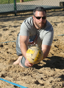 Candace H. Johnson-For Shaw Media Jason Dipietro, of Lake Zurich with That's What She Set dives for the ball against the Sandy Balls family team during the recreational volleyball game at Sideouts Sports Tavern in Island Lake.That's What She Set won 21-14, 21-13, and 21-14.(6/24/18)